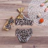 Красивый модный тигровый с повязкой и золотыми бантиками