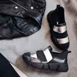 Черные кожаные кроссовки со стрейчем и серебристыми резинками
