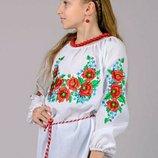 Яркая детская блуза вышиванка.