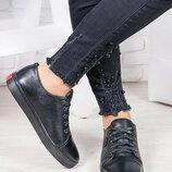 Стильные и модные черные кеды