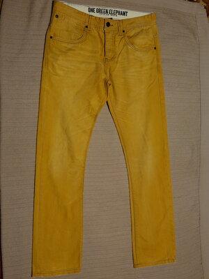 Эффектные х/б джинсы -варенки цвета охры с потертостями One Green Elephant Германия 33/32 р.