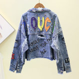 Женская джинсовая куртка рванка Pouce с разноцветным принтом голубая