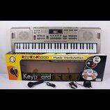 Пианино синтезатор с USB 61 клавиша MQ 816. Работает от батареек. Есть микрофон.