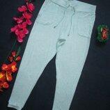 Суперовые трикотажныемеланжевые стрейчевые тепленькие спортивные штаны George.