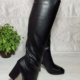 Зимние кожаные сапоги на каблуке