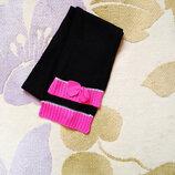 Вязаньій шарфик украшенньій бантиком