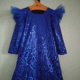 Нарядное эффектное платье на девочку блестящее