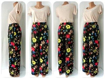 Стильные, яркие брюки H&M с цветочным принтом. Размер eur36, S.