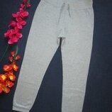 Шикарные трикотажные фирменные теплые спортивные штаны серый меланж с начесом Champion.