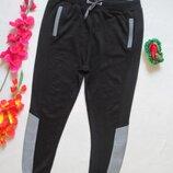 Суперовые трикотажные спортивные штаны с контрастными вставками высокая посадка Innocence.