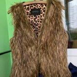 Шикарная меховая жилетка от Gucci