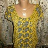 Яркая блуза с интересным принтом TU
