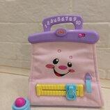 Музыкальная развивающая сумочка Fisher-Price с игрушечной помадой.