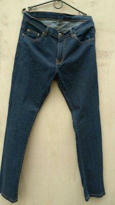 Фірмові звужені стрейчові джинси 33 32