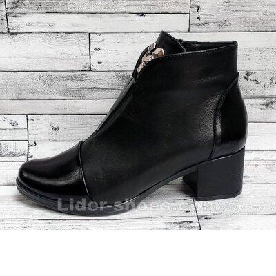 Женские кожаные ботинки на среднем каблуке