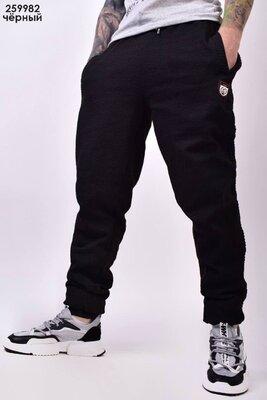Спортивные штаны мужские на манжете.