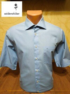 Практичная деловая рубашка с коротким рукавом известной немецкой марки Seidensticker.