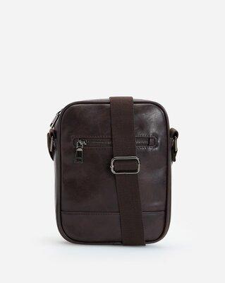 Стильная брендовая мужская сумка Reserved на регулирующемся широком ремешке.